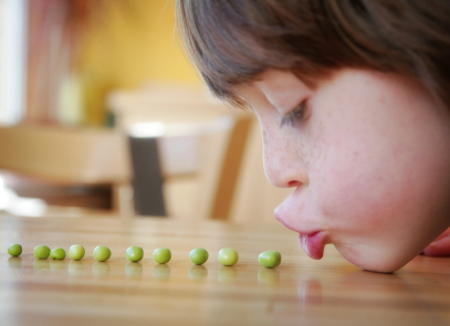 http://greenandcleanmom.org/wp-content/uploads/2009/12/child-eating-healthy-vegetables.jpg