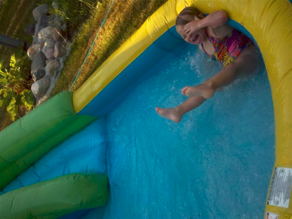 Simple summertime joys of being a child - the backyard water slide!